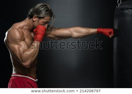 портрет серьезный молодым человеком красный боксерские перчатки белый Сток-фото © wavebreak_media