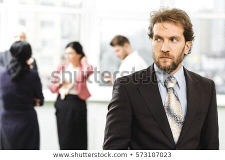 üzletember néz gyanús izolált üzlet szemüveg Stock fotó © fuzzbones0