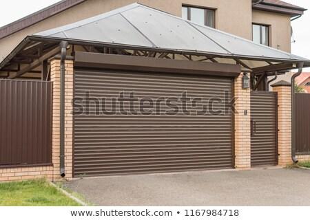 Industriële rollen sluiter garage deur muur Stockfoto © stevanovicigor