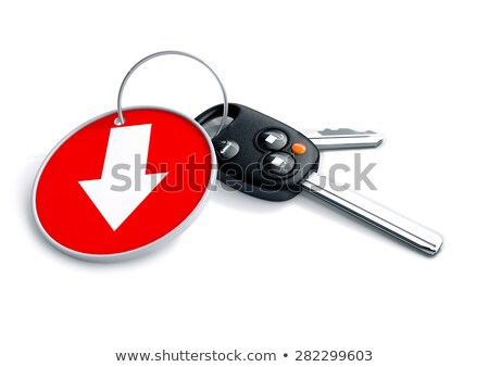 Set of car keys and keyring isolated on white with arrow on red  Stock photo © crashtackle