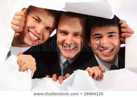 Three young smiling men looking out in hole in paper Stock photo © Paha_L