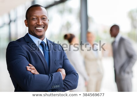 afro american man standing with arms folded stock photo © deandrobot