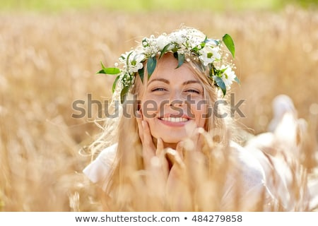 pretty happy young woman in beautiful wreath of flowers stock photo © deandrobot