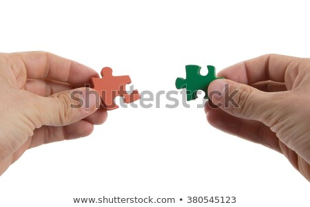 Close-up of hands trying to connect big jigsaw puzzle pieces Stock photo © michaklootwijk