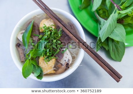 exotic asian noodle soup served with chopsticks stock photo © zuzuan