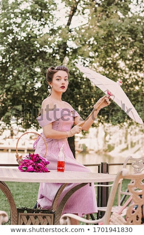 Portrait of beautiful pinup girl with umbrella Stock photo © deandrobot