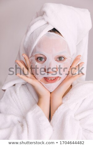 Attractive gentle young woman in bathrobe in spa salon Stock photo © deandrobot