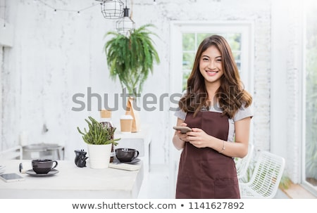 beautiful young woman waitress in a restaurant stock photo © studiostoks