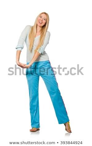 Jonge vrouw Blauw opleiding pants geïsoleerd Stockfoto © Elnur