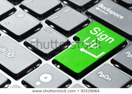 A keyboard with a green button - Sign up Stock photo © Zerbor
