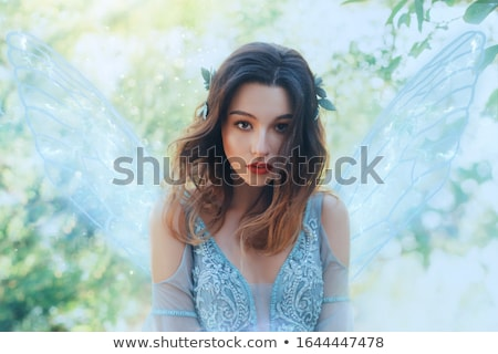 Beauty portrait of tender young woman with sparkles on face Stock photo © deandrobot