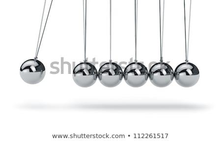 Newtons Cradle isolated on the white background Stock photo © kayros