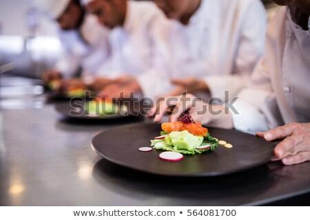 Mężczyzna kucharz przekąska tablicy celu Zdjęcia stock © wavebreak_media