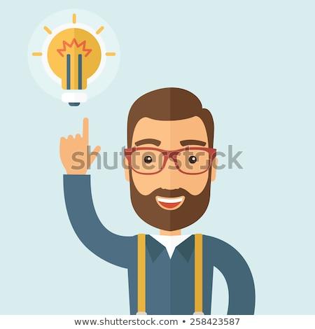Caucasian businessman pointing at idea lightbulb. Stock photo © RAStudio