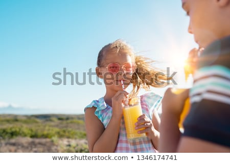 Boy smiling with a glass of orange juice stock photo © IS2