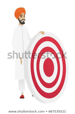 Young hindu businessman and dart board. Stock photo © RAStudio