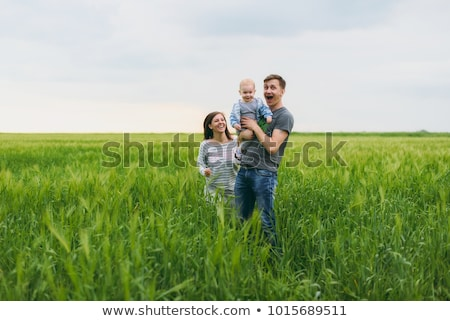 man and woman standing in field stock photo © is2