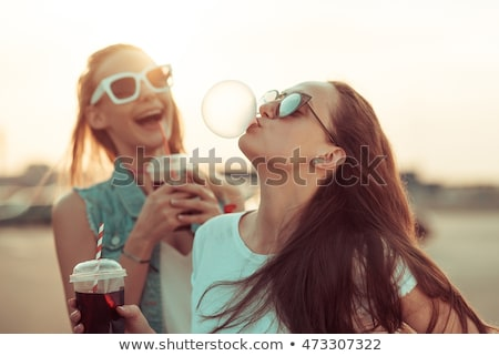 Teen girls laughing and eating Stock photo © IS2