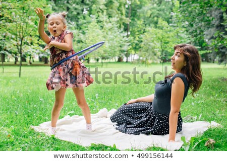 Mother and daughter playing with hoop Stock photo © IS2