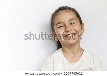 счастливым · девочку · очки · указывая · пальца · вверх - Сток-фото © deandrobot