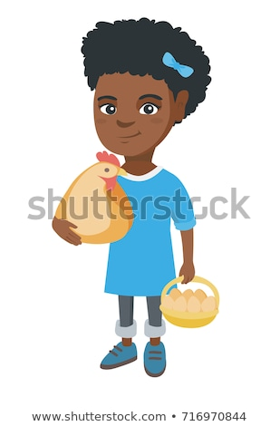 African girl holding a chicken and hen eggs. Stock photo © RAStudio