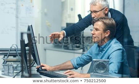 Férfi néz építészeti modell üzlet iroda Stock fotó © IS2