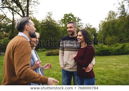 話し 祖父母 立って 屋外 女性 ストックフォト © deandrobot