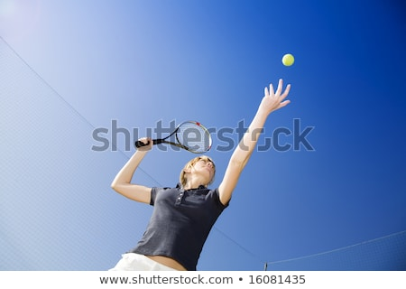 Low angle view of woman playing tennis Stock photo © IS2