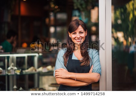 Woman standing in doorway of restaurant smiling Stock photo © monkey_business