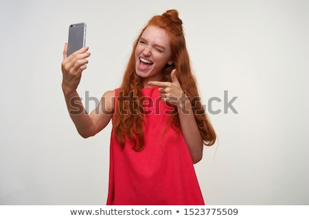 Stock photo: Facial Expressions Of Young Redhead Woman Closeup