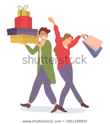 happy man standing isolated holding present gift box for his woman stock photo © deandrobot