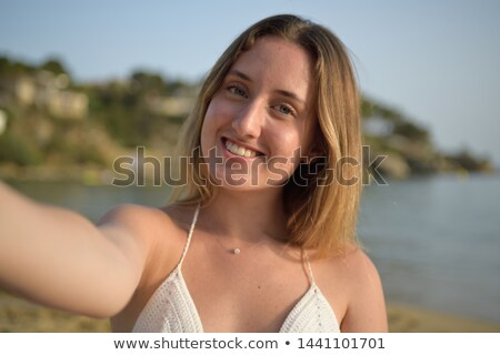 Portrait of a calm woman taking a sunbath by the sea Stock photo © majdansky