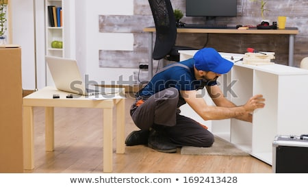 assembler with screwdriver making furniture Stock photo © dolgachov