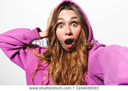Stock photo: Portrait of surprised woman 20s wearing sweatshirt laughing whil