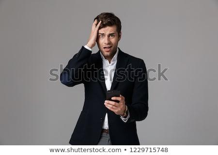 недоуменный · бизнесмен · служба · глядя · камеры · женщину - Сток-фото © deandrobot