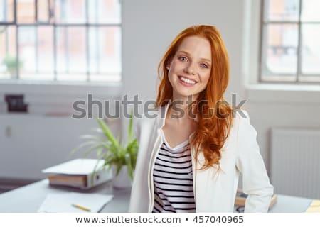 glimlachend · jonge · vrouw · kantoor · vrouw · gelukkig · werk - stockfoto © Minervastock