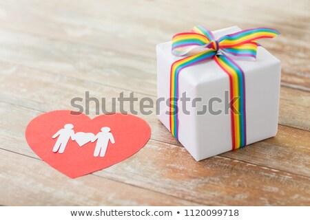 ストックフォト: Gift With Gay Awareness Ribbon And Male Pictogram