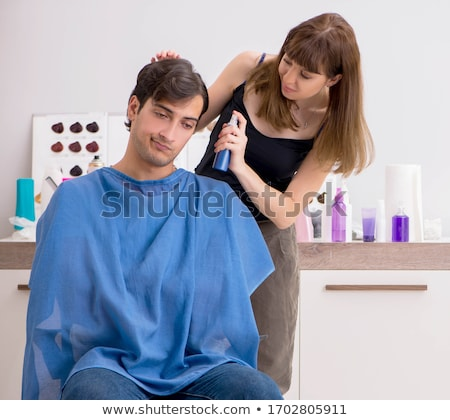 The young attracrive man visiting female barber  Stock photo © Elnur