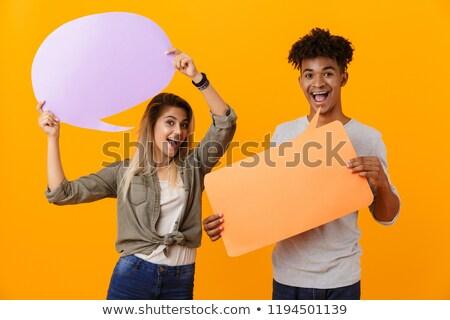 Fiatal szerető pár áll izolált citromsárga Stock fotó © deandrobot