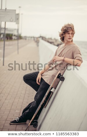 portrait of relaxed casual man holding hips in the city Stock photo © feedough