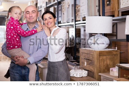 portrait of a happy family together in the interior of a modern shop stock photo © kzenon