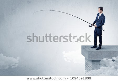 Foto d'archivio: Businessman Fishing Nothing From The Top