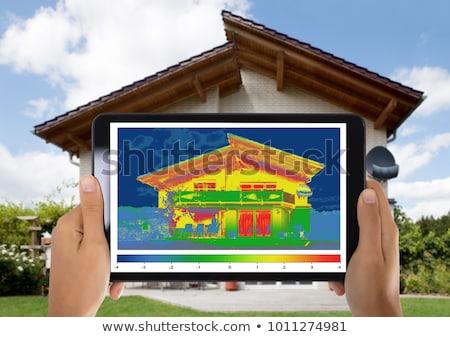 Hő veszteség energiahatékonyság ház közelkép személy Stock fotó © AndreyPopov