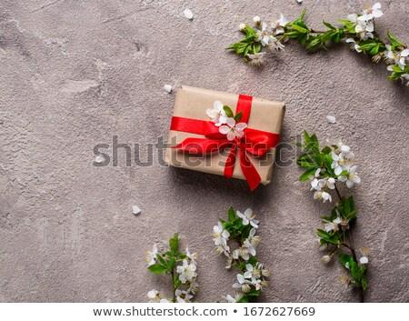 Cherry or plum blossom and gift box Foto d'archivio © furmanphoto