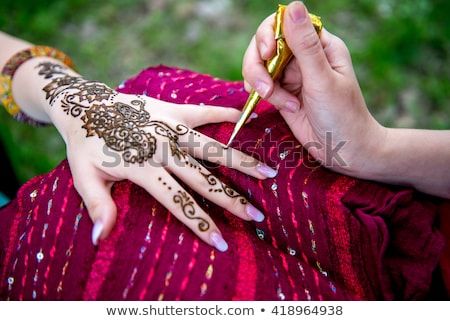 Stockfoto: Picture of human hand decorated with henna Tattoo. mehendi hand