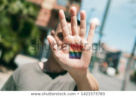 man · regenboog · vlag · hand · jonge - stockfoto © nito