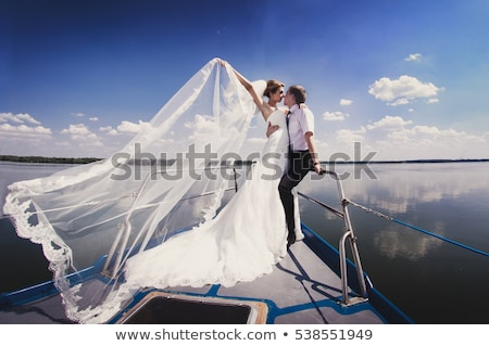 Bride and groom wedding on pier with boats on the sea Stock photo © ElenaBatkova