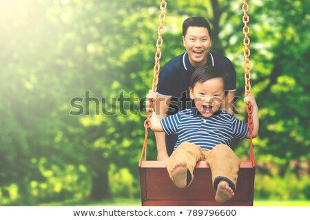 A father have fun play on park with his son Stock photo © Lopolo