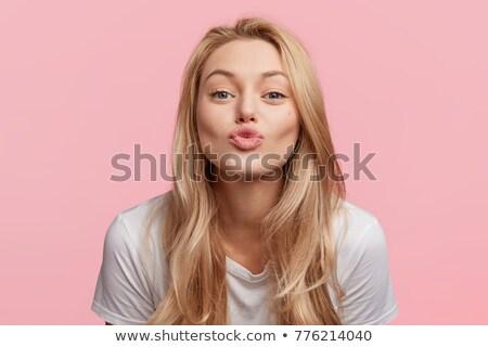 Mooie jonge vrouw gezonde huid poseren geïsoleerd Stockfoto © deandrobot