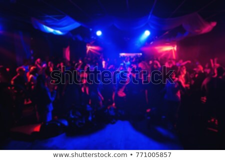 dancing people in disco club under spotlights stock photo © robuart